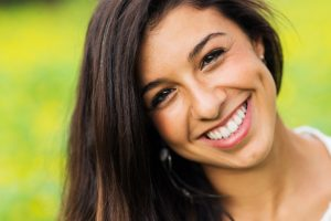 A smiling young hispanic woman with dark brown hair and staright white teeth. Possibly a patient of Cosmetic Dentistry of Murfreesboro - a dentist office in Murfreesboro, TN.