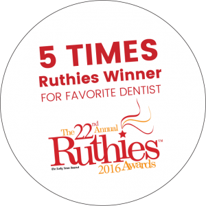 "A white circle with the words ""Five times Ruthies Winner for Favorite Dentist"" in red as well as the words ""twenty-second"" and ""Ruthies"" in red. The words ""The"", ""Annual"" and ""2016 Awards"" are in gold. The words ""The Daily News Journal"" is below that in black."